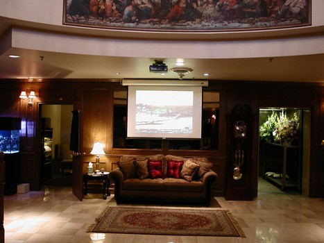 Funeral home with ceiling mounted projector and electric screen