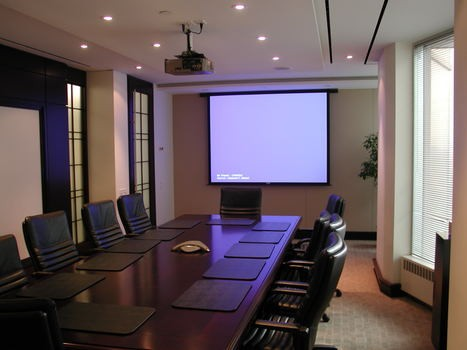 Executive Boardroom with recessed electric screen and ceiling mounted projector