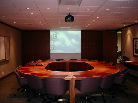 Boardroom with Crestron control system allowing for control of all audio video components within the room
