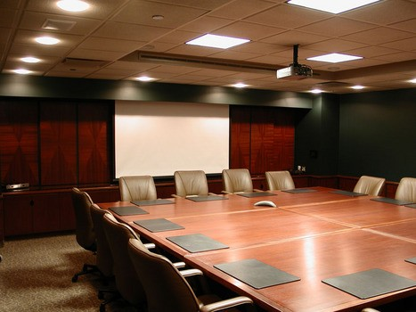 Boardroom Installation with ceiling mounted projector and recessed electric screen